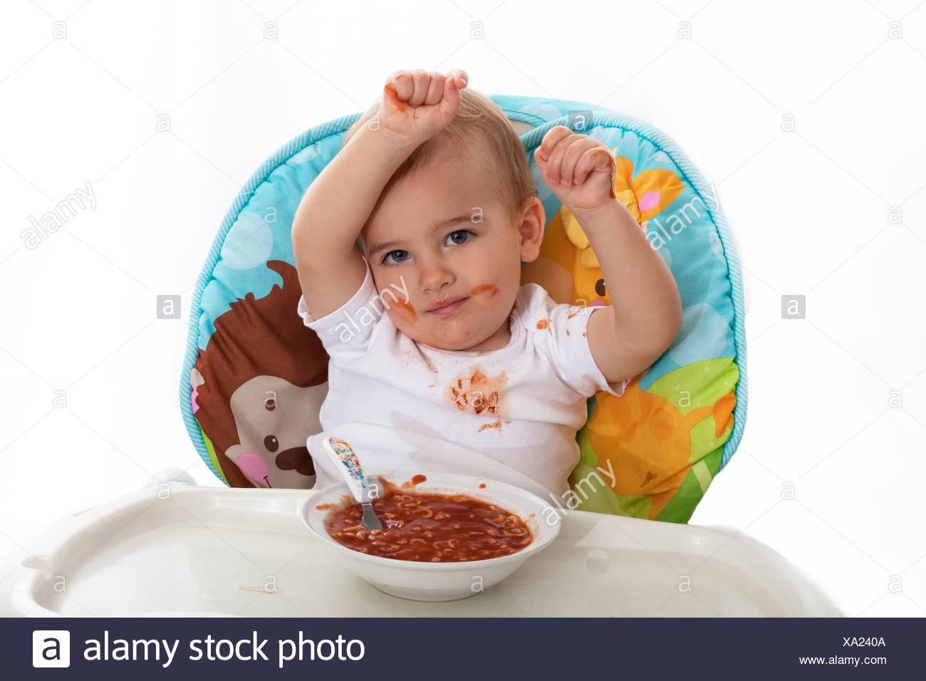 Baby mealtime mess - Stock Image