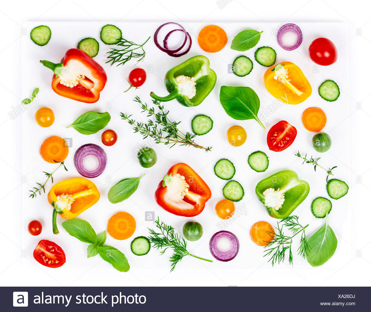 Composition of Fresh organic vegetables (pepper, onion, cucumber, carrot, tomatoe), herbs, olive oil and vinegar  isolated on white background, top vi - Stock Image