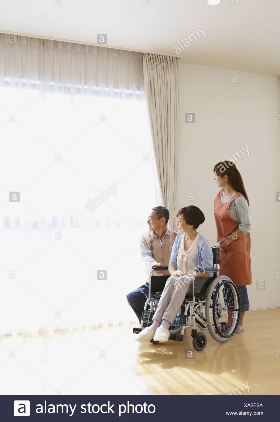 Home helper and senior couple - Stock Image