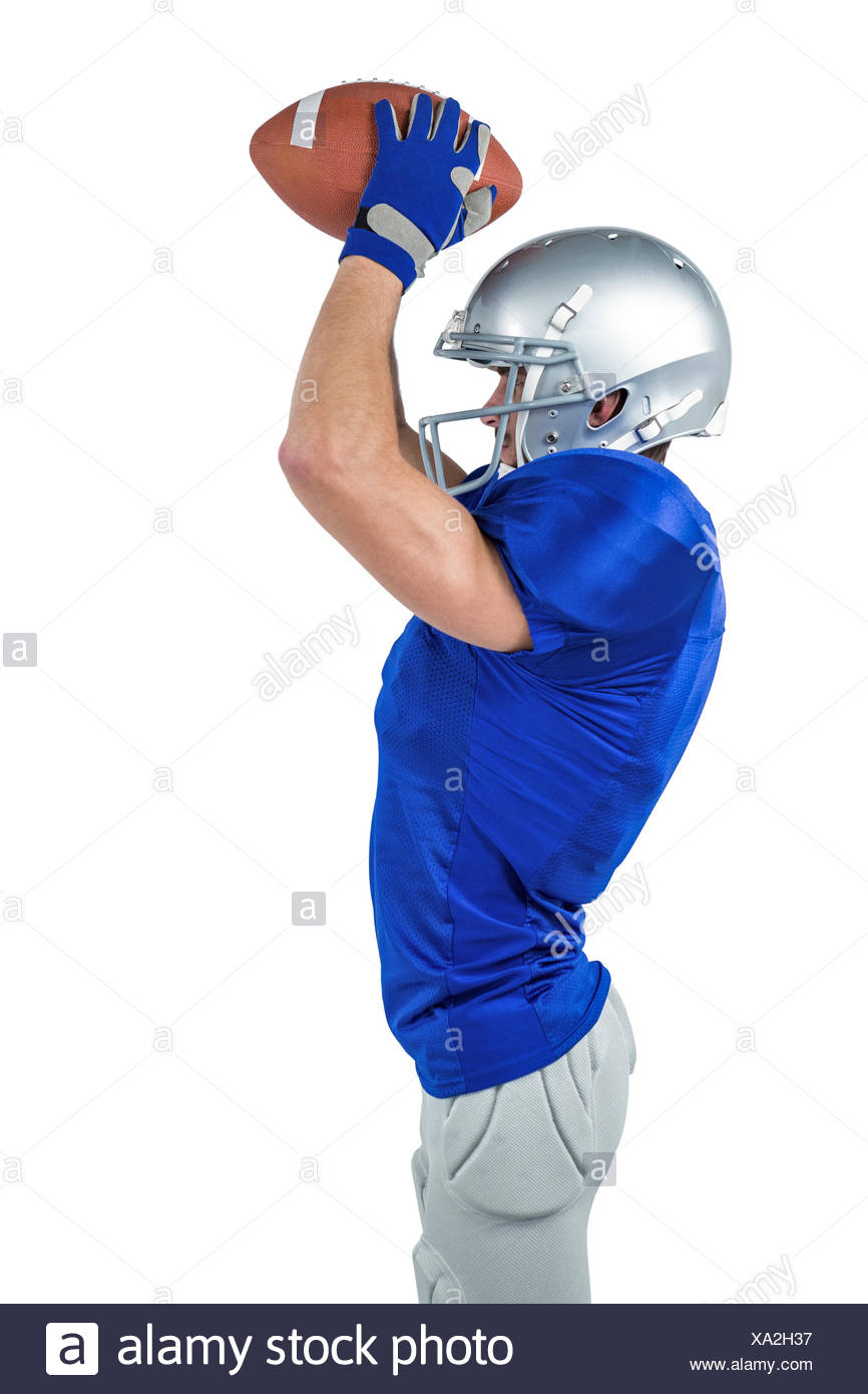 Side View Of American Football Player Catching Ball Stock