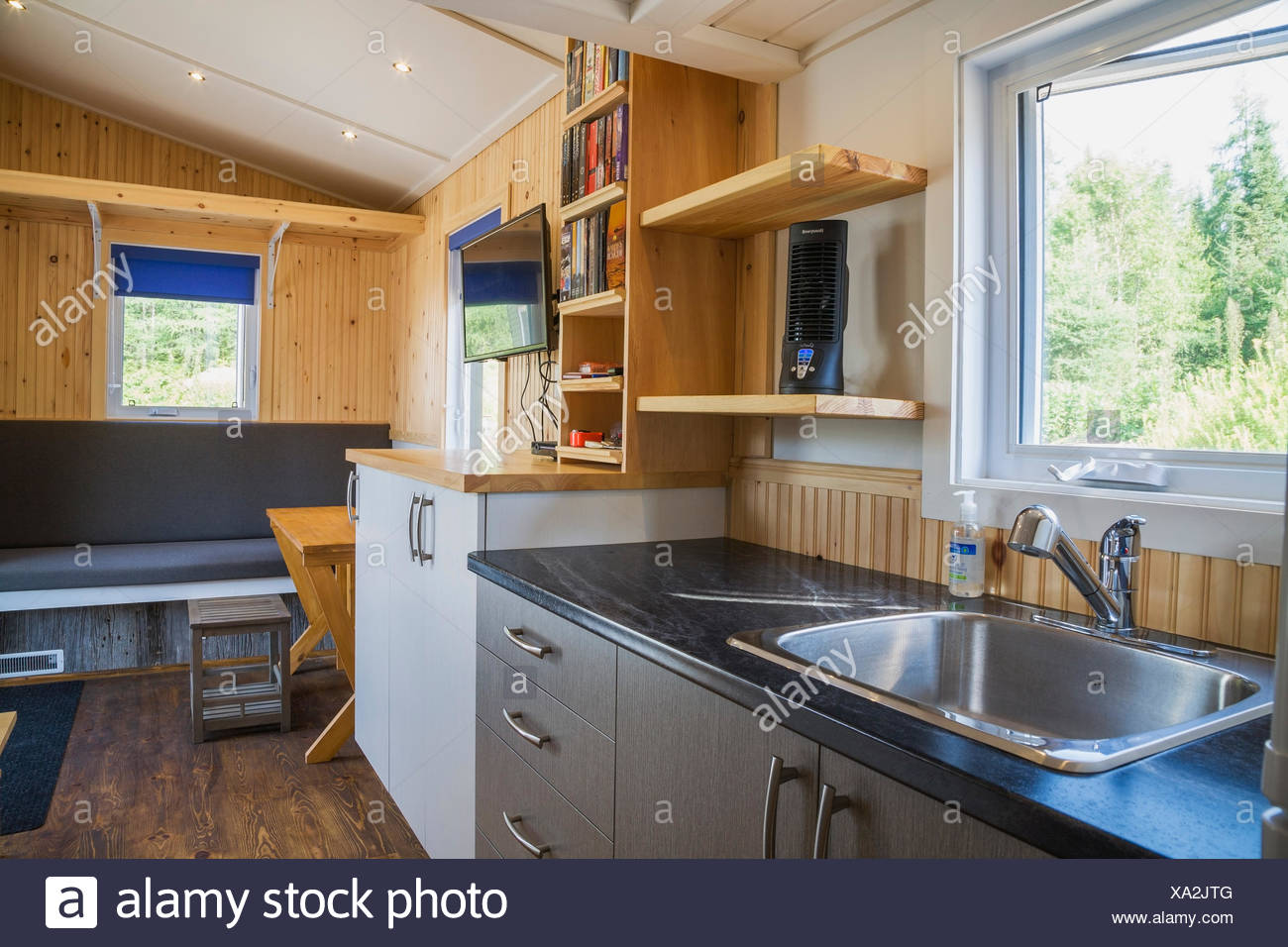 Brown Stained Pinewood Floor And View Of Kitchen Counters Grey And