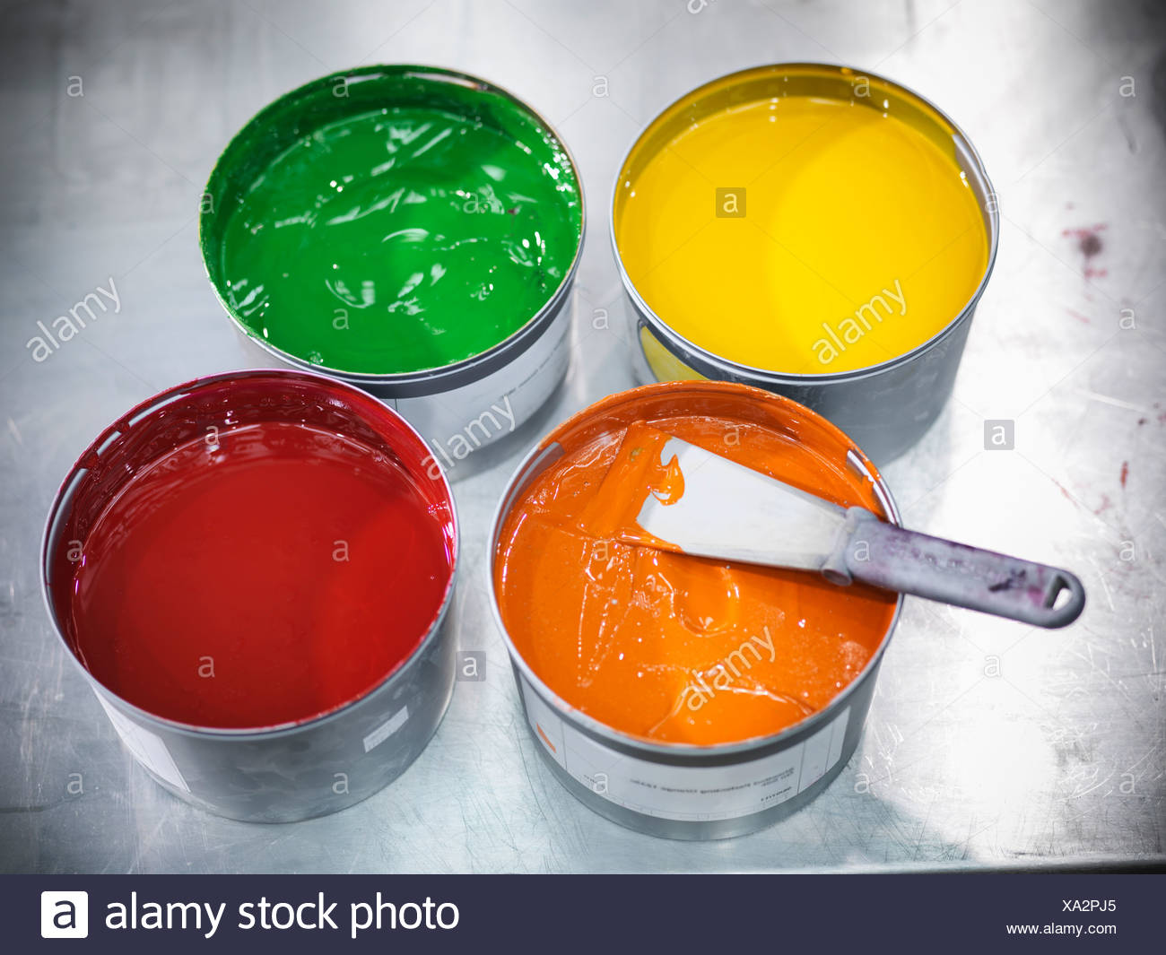 Buckets of colorful printing ink - Stock Image