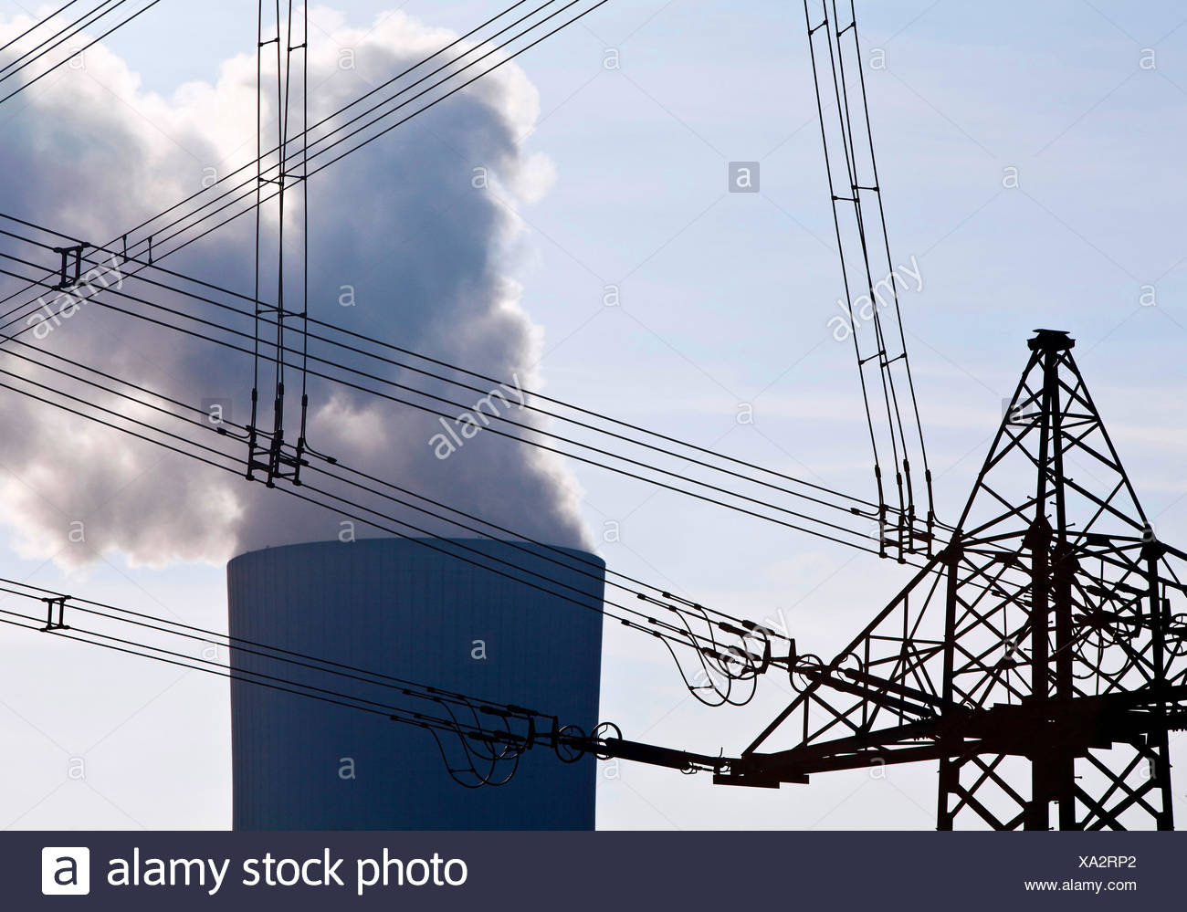 power pole with high voltage power lines and industry, Germany, North Rhine-Westphalia - Stock Image