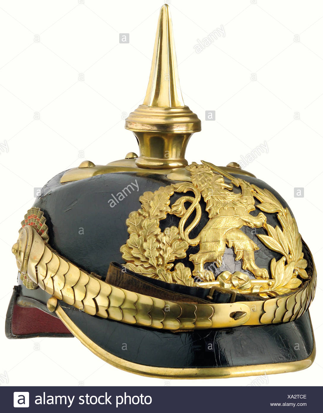 Hesse: A helmet for officers, of infantry regiments Nos. 116, 117 (until 1898), 118 and 168. The crown of the leather skull is slightly sunken, the lacquer shows a little crazing, and the rear peak is somewhat loose. Brass fittings with some traces of gilding, and a gilt plate. Cambered chinscales attached to officers' style cockades. A yellow ribbed silk liner, and a dark brown sweatband with slight traces of wear. Size 55. historic, historical, 19th century, object, objects, stills, clipping, clippings, cut out, cut-out, cut-outs, helmet, helmets, headpiece, , Additional-Rights-Clearances-NA - Stock Image
