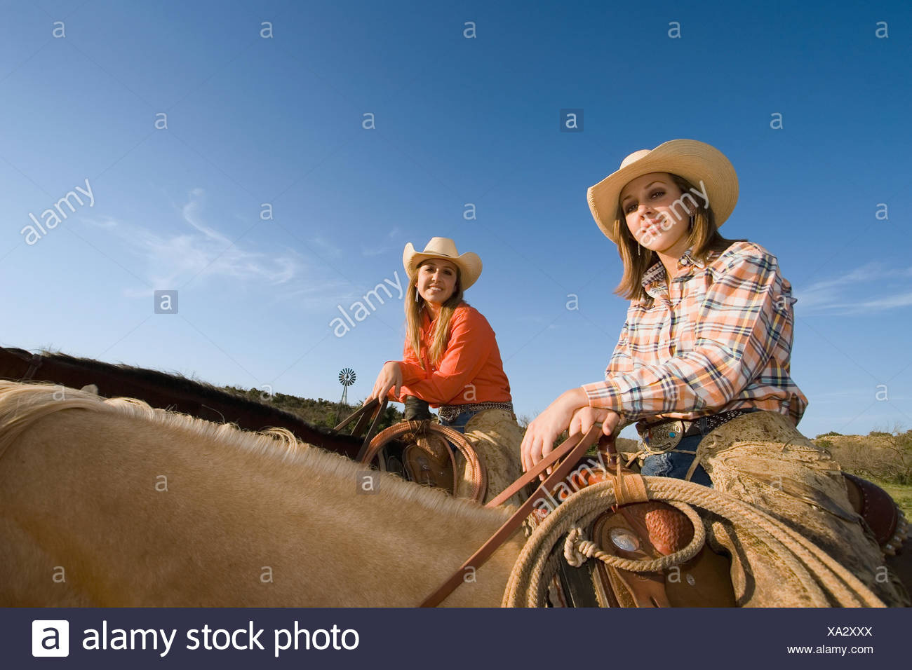 1d5906af28ca4 Agriculture - Young cowgirls smile while sitting on their horses    Childress