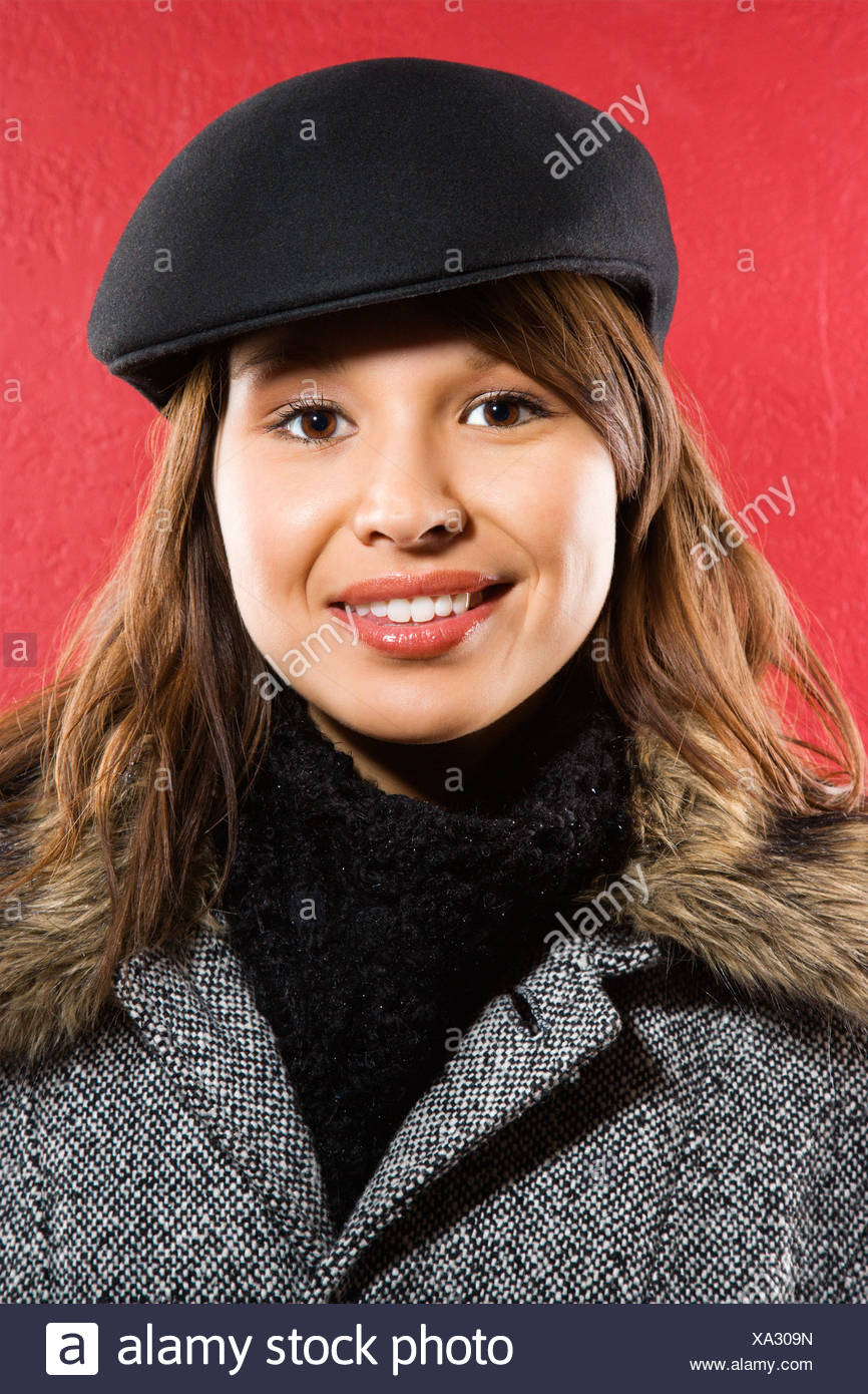 cfee1fff1447a Young adult Caucasian woman wearing flat hat smiling at viewer Stock ...
