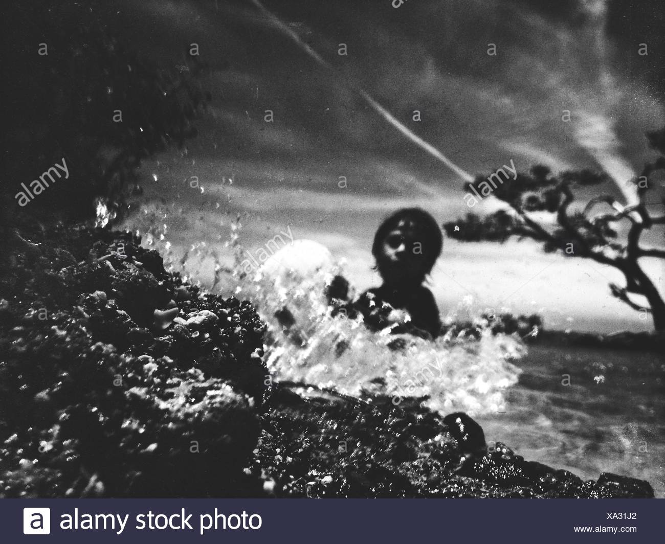 Person Swimming In Sea Against Sky Stock Photo