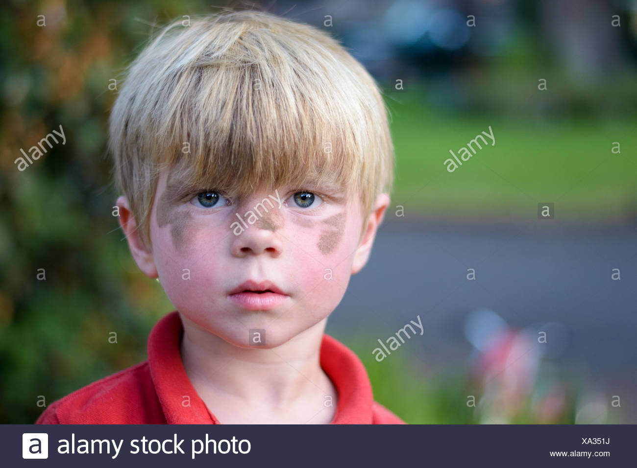 Boy with dirty face (4-5 years) - Stock Image