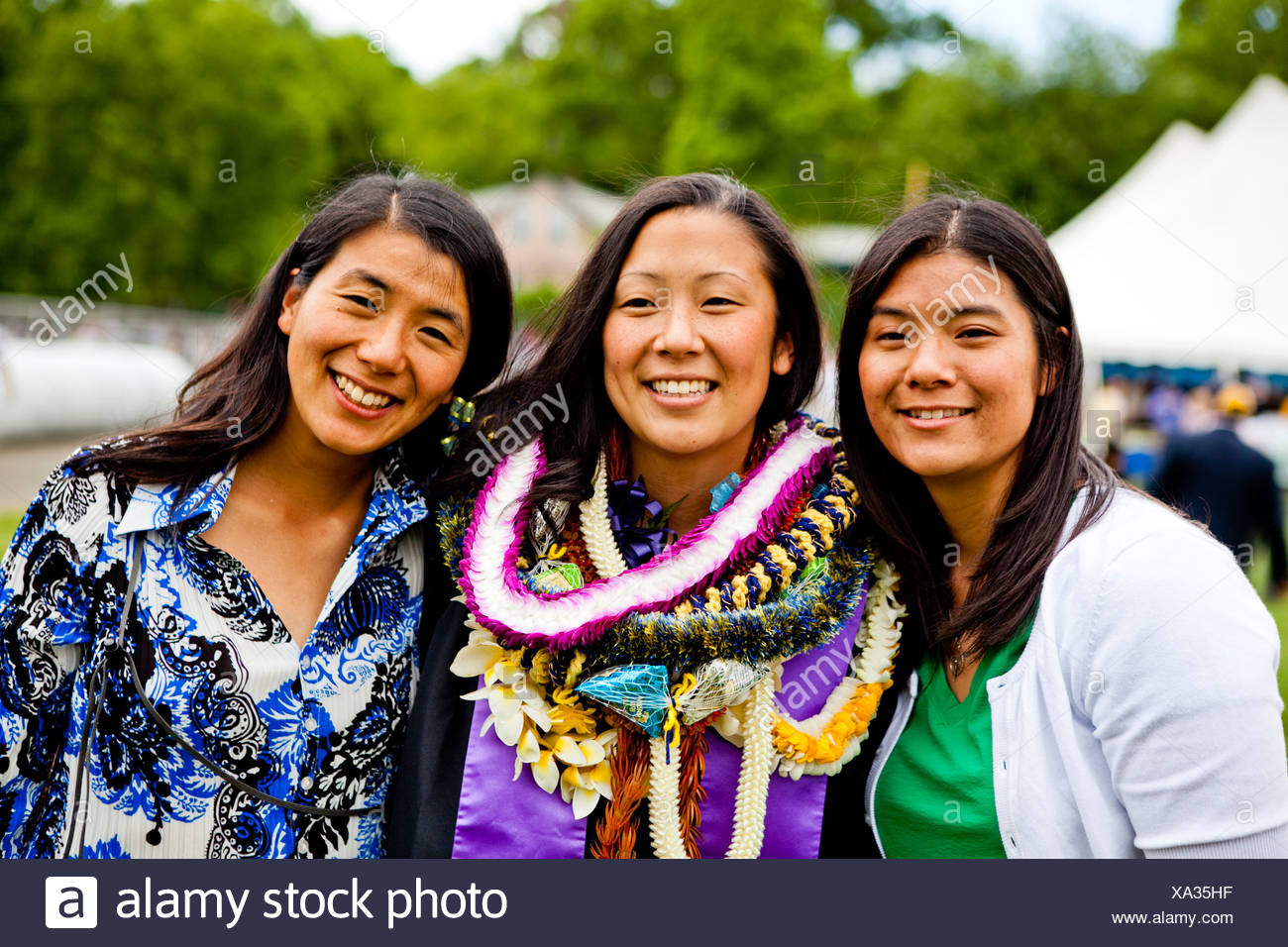 Sisters pose for the camera. - Stock Image