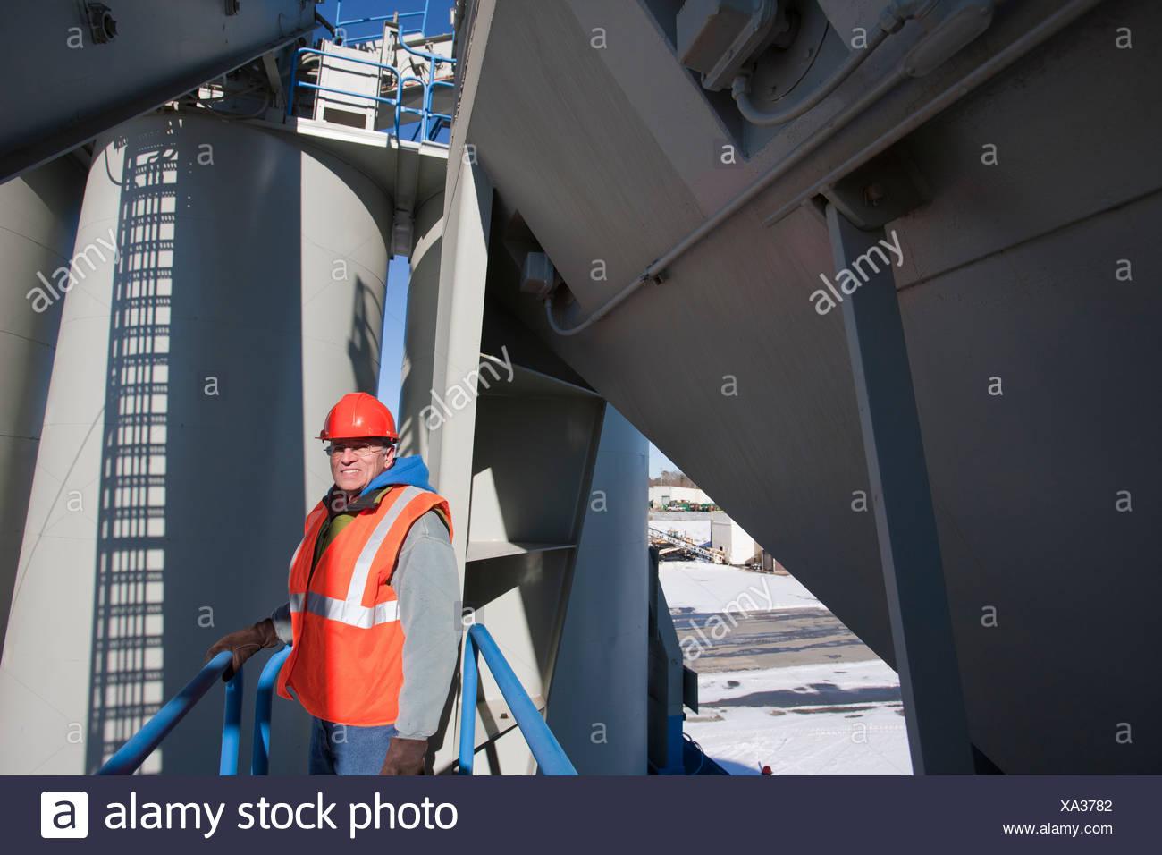 Engineer standing on inspection platform - Stock Image