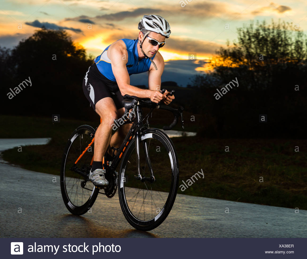 Germany, triathlete riding bicycle - Stock Image