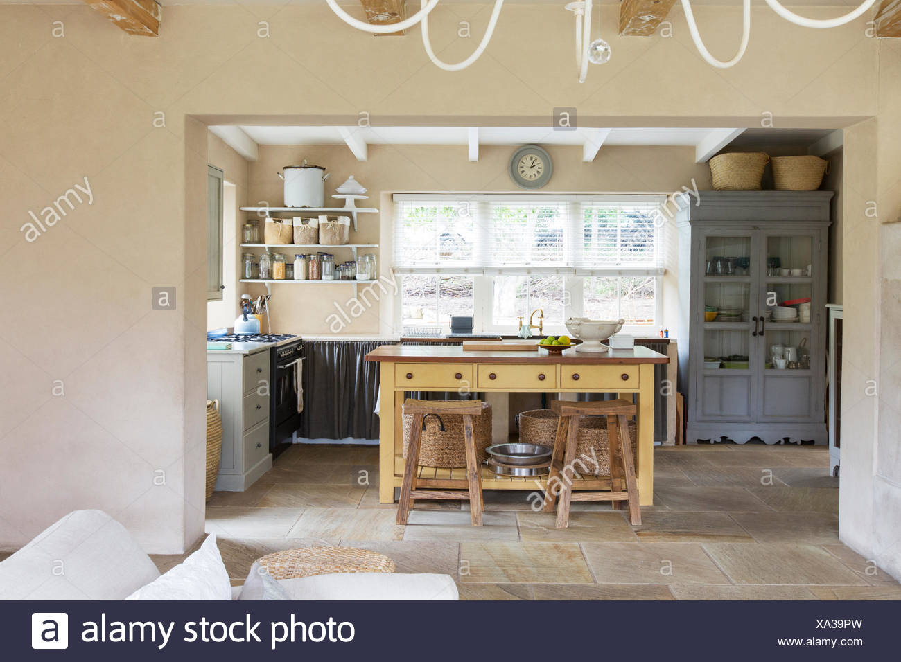 Island in kitchen of rustic house - Stock Image