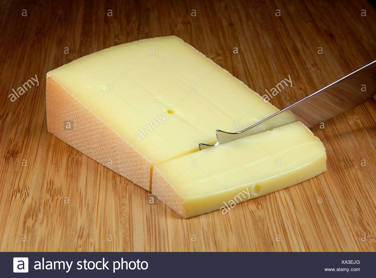 A piece of swiss saentis cheese - Stock Image