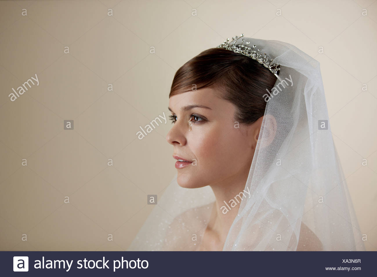 A young bride with a tear running down her face - Stock Image