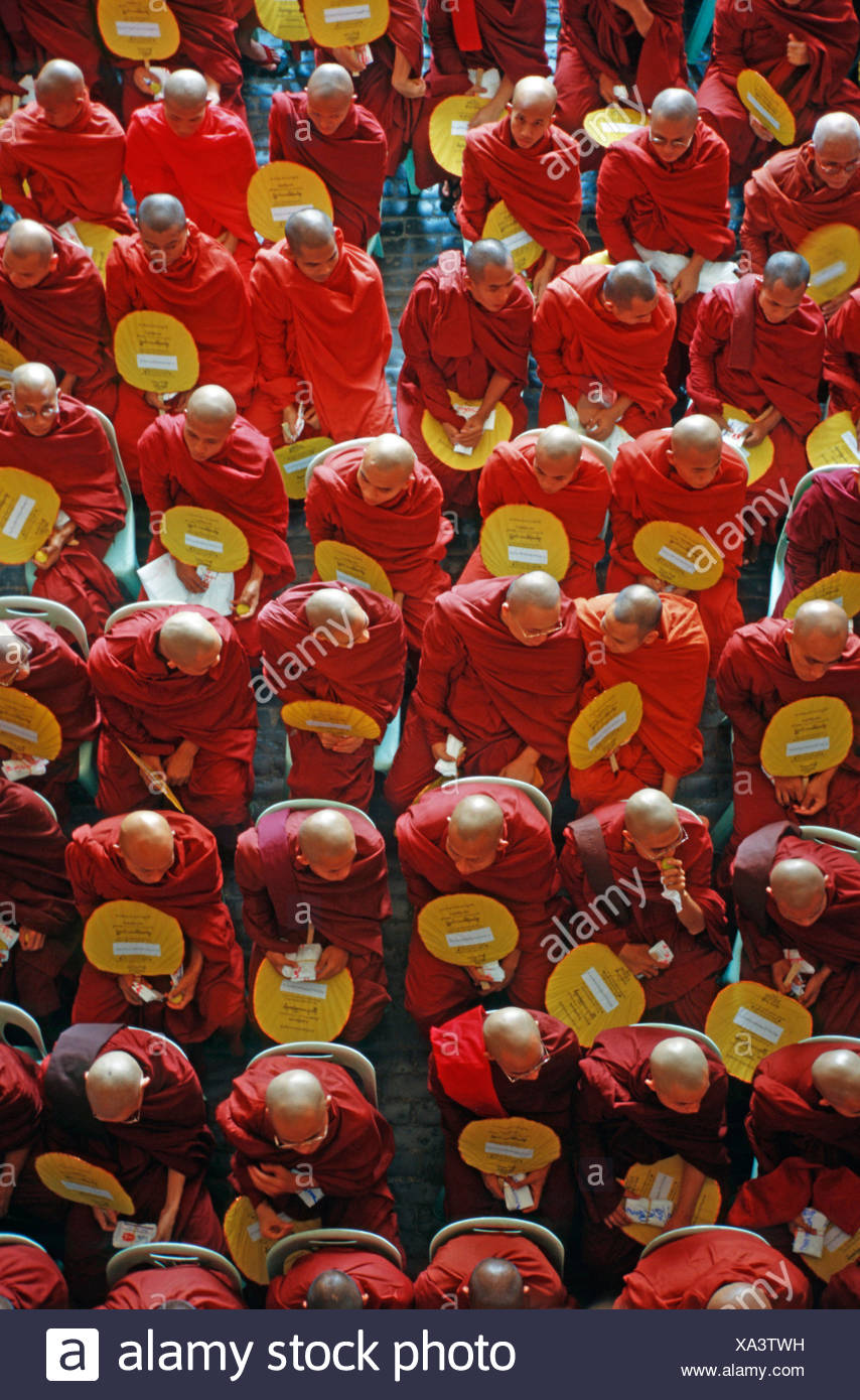 Monk gathering at the induction of a department store, Yangon, Burma, Asia - Stock Image