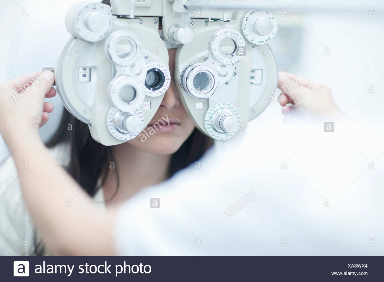 Optician testing patients sight - Stock Image