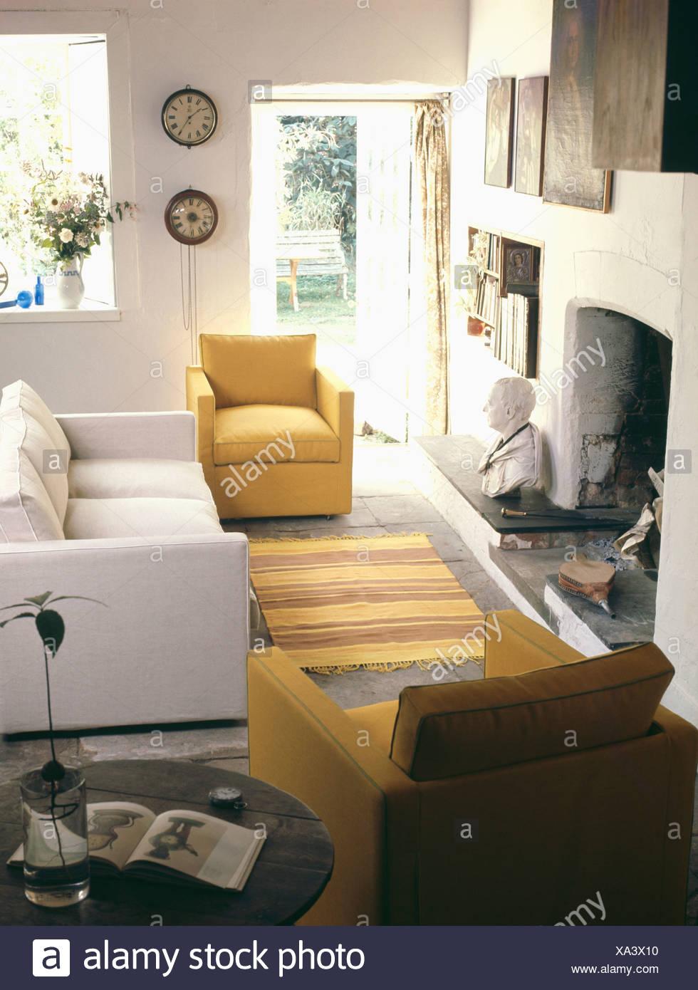 Yellow Sixties Habitat Armchairs And White Sofa In Seventies
