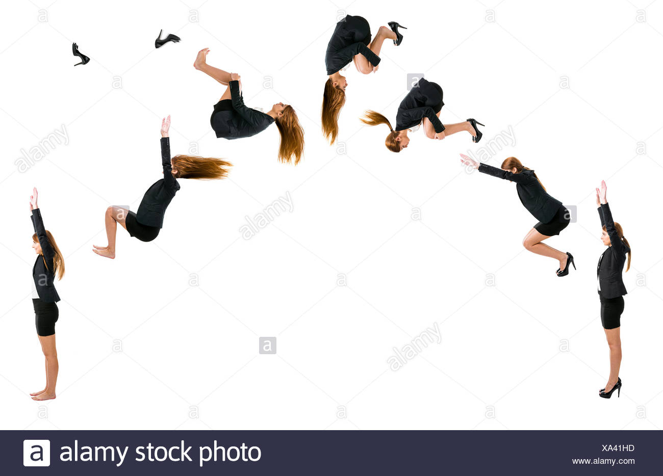 Business woman making  a front flip - Stock Image
