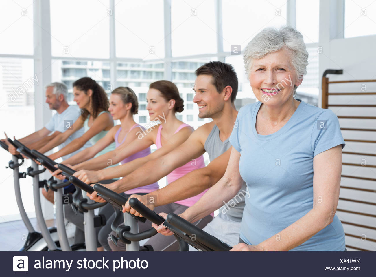 Happy people working out at spinning class Stock Photo