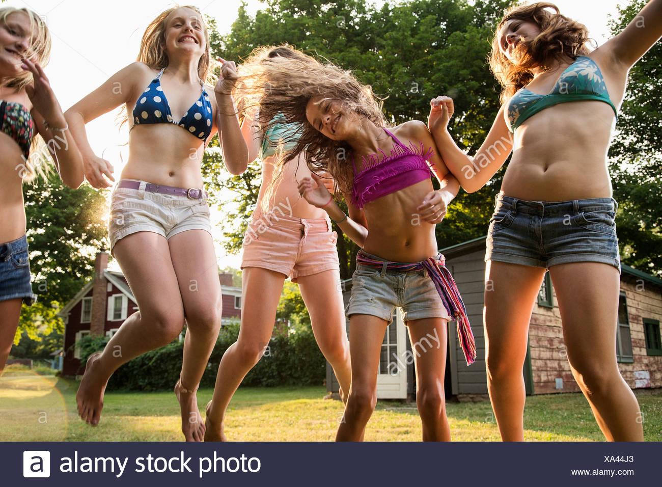 Girls dancing in garden Stock Photo
