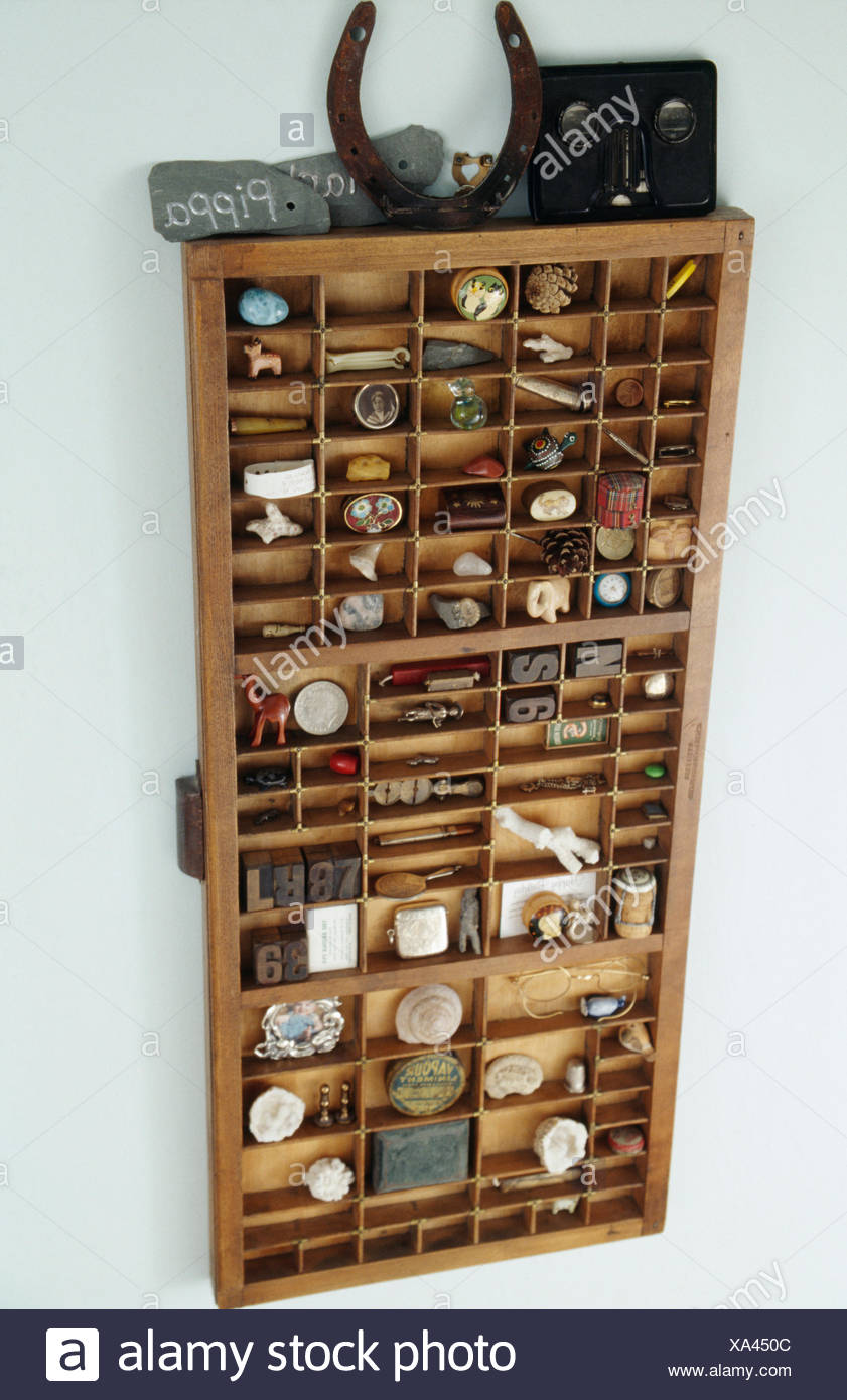Close-up of old print tray with collection of found objects - Stock Image