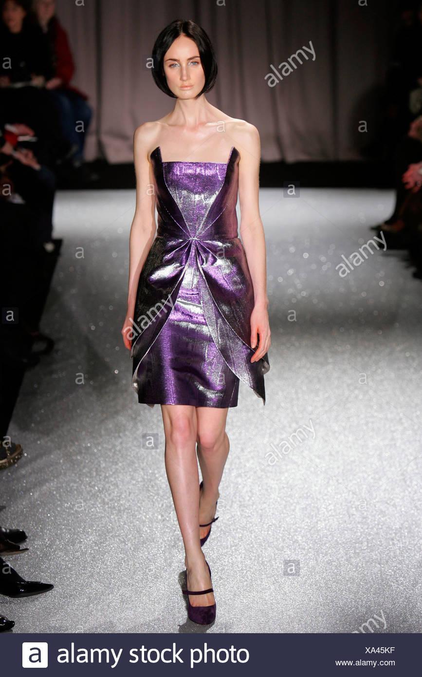 96403672bd Martin Grant Paris Ready to Wear Autumn Winter Model wearing purple  metallic strapless layered dress