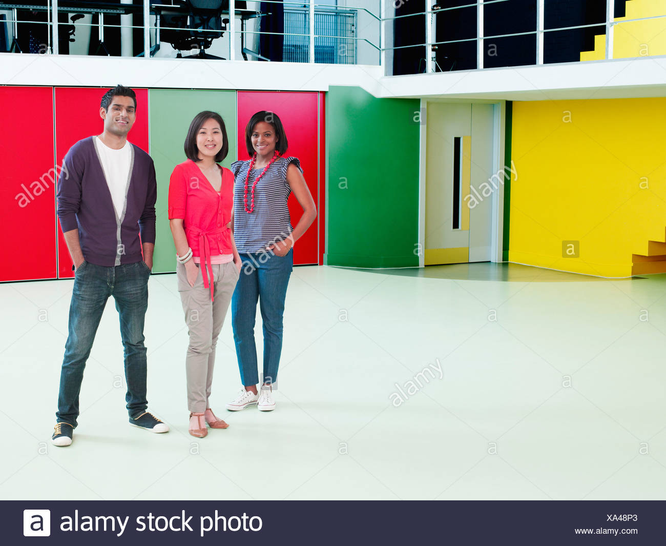 Smiling business people in empty office Stock Photo