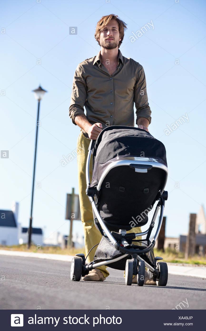 Man Pushing A Baby Stroller Stock Photo 281607838 Alamy