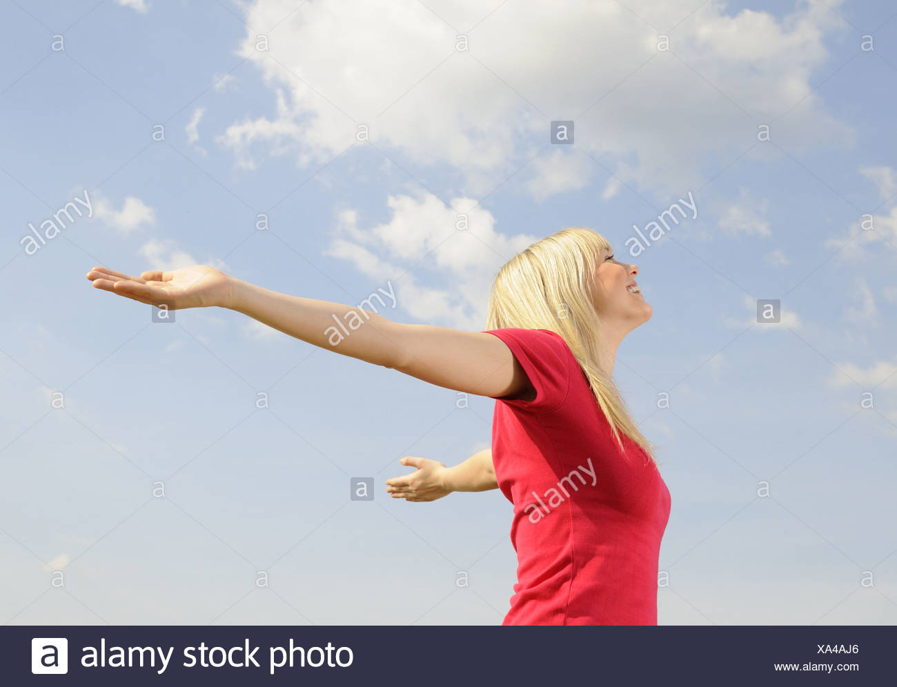 young woman spreads her arms Stock Photo