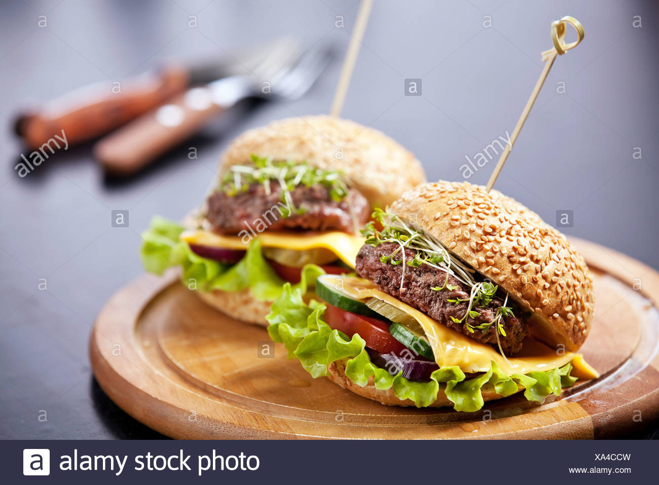 Two burgers with meat and greens - Stock Image