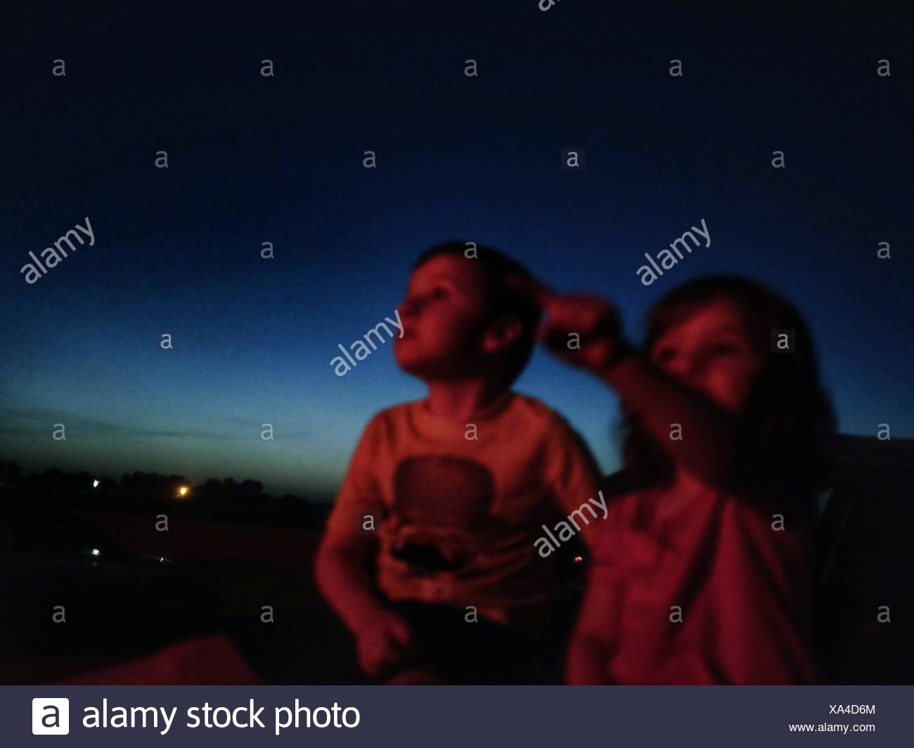 Children Looking At The Night Sky - Stock Image