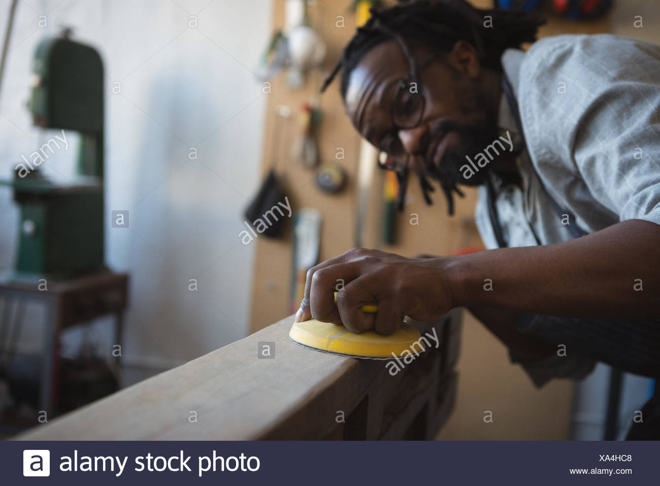 Carpenter leveling wood with work tool - Stock Image