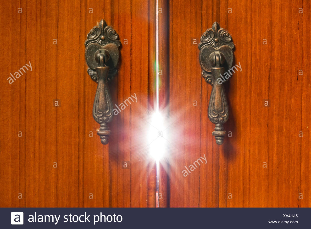 Mystery light from the cabinet - Stock Image