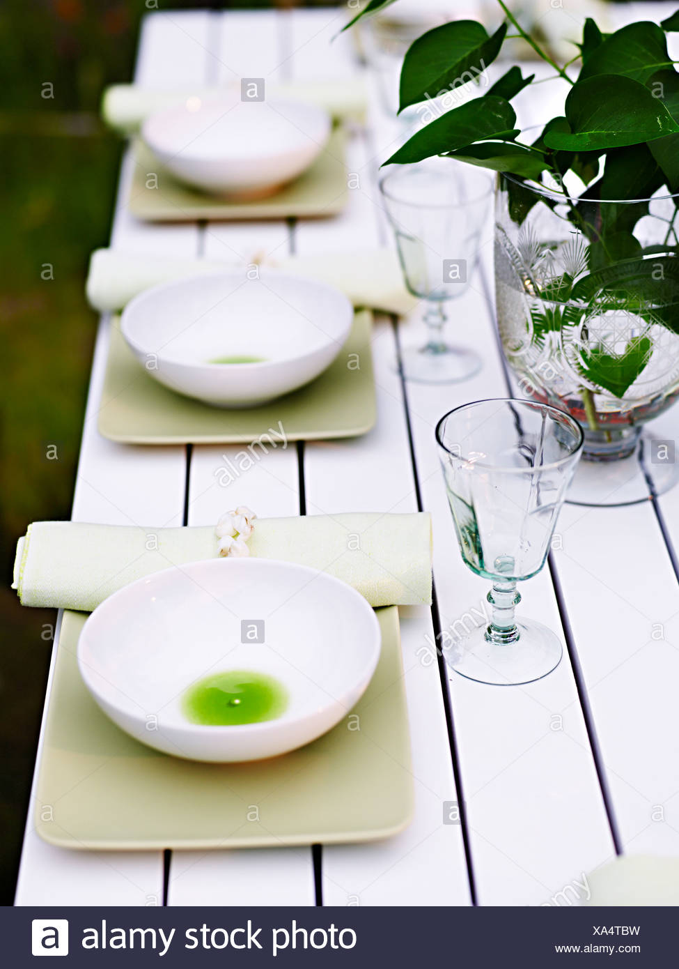 A laid table outdoors, Sweden. - Stock Image