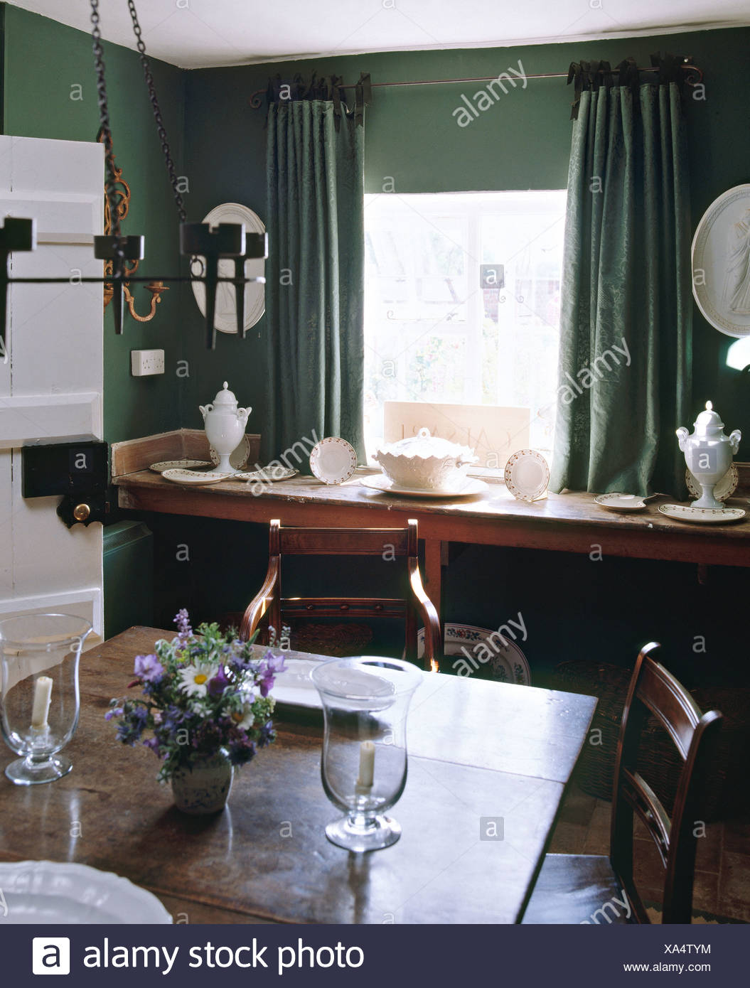 Oak Table And Antique Chairs In Dark Green Cottage Dining Room With Simple Side Below