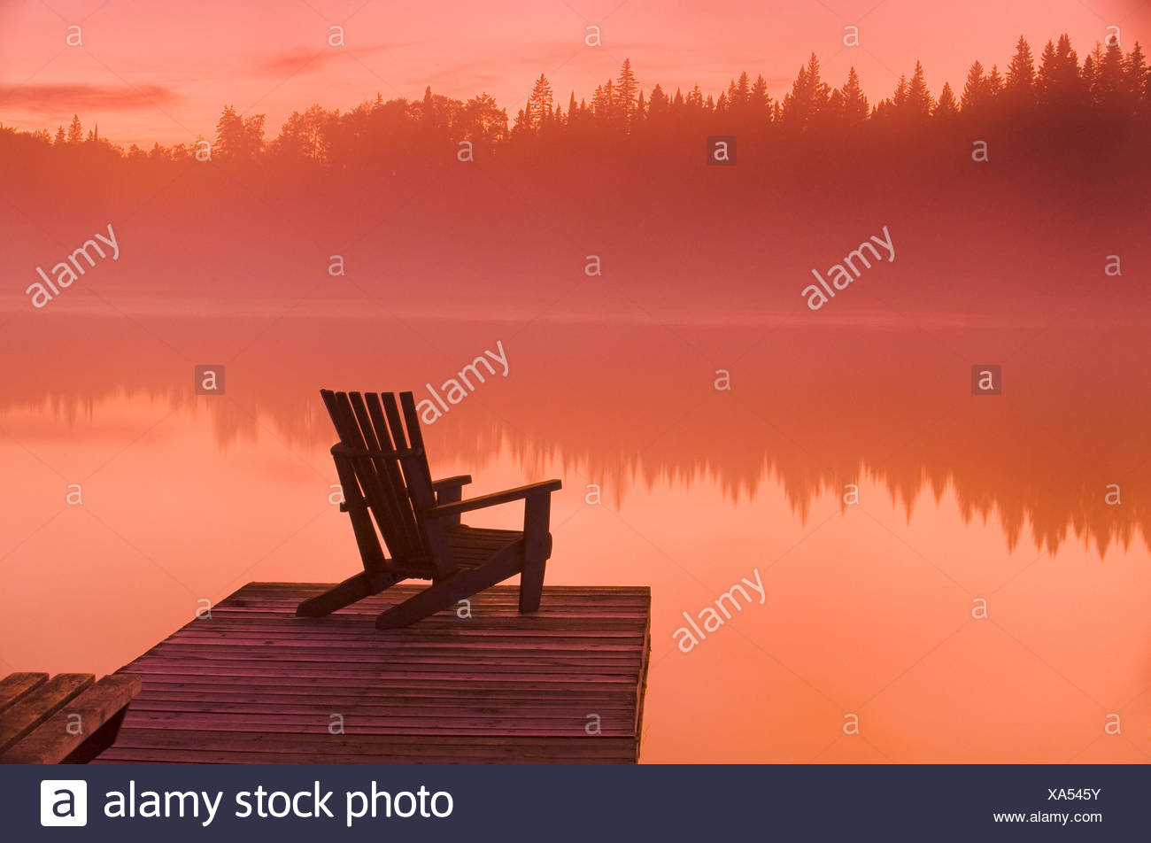 Muskoka chair on dock, Glad Lake, Duck Mountain Provincial Park, Manitoba, Canada - Stock Image