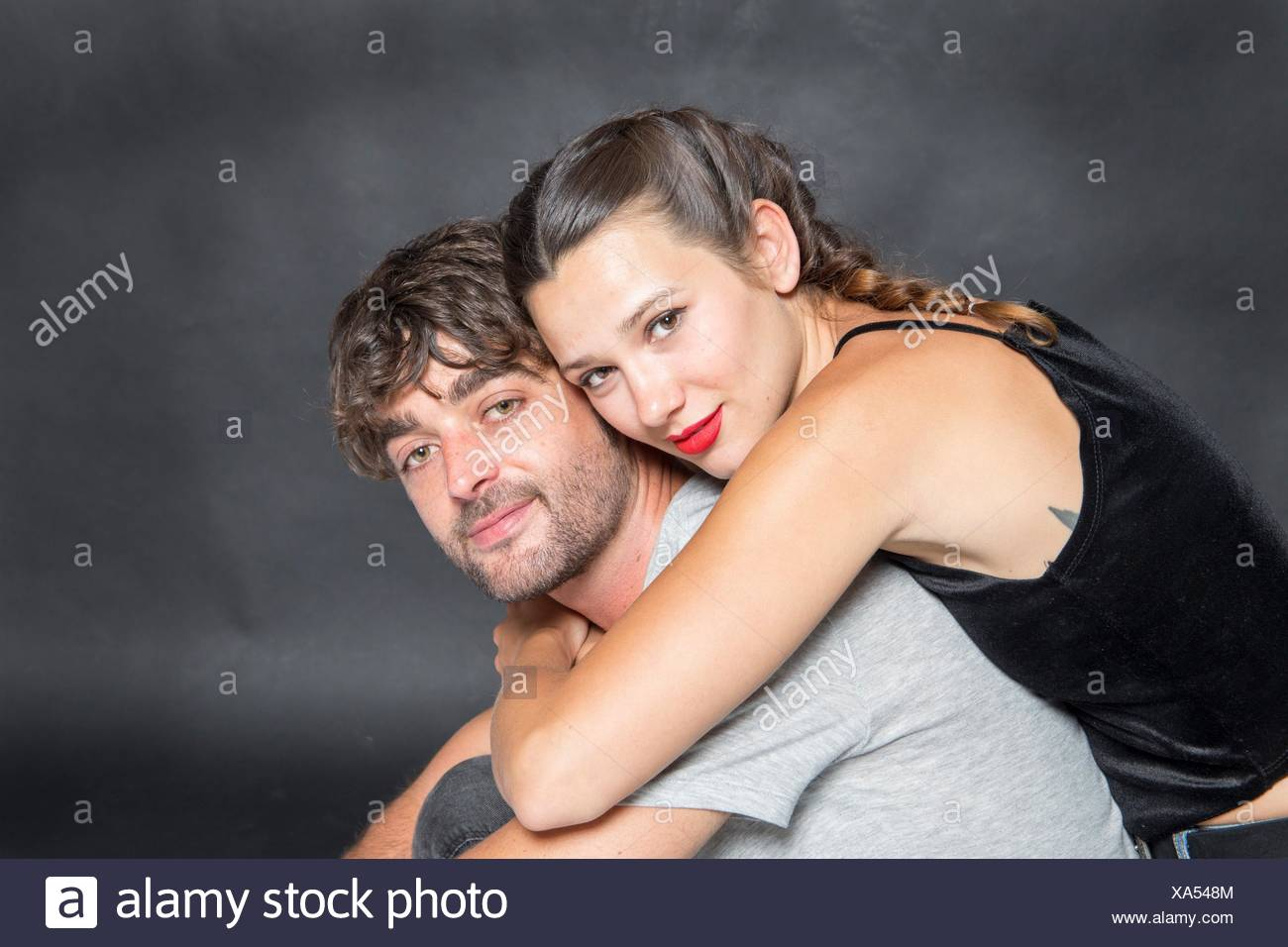 Mid-adult couple looking at camera - Stock Image