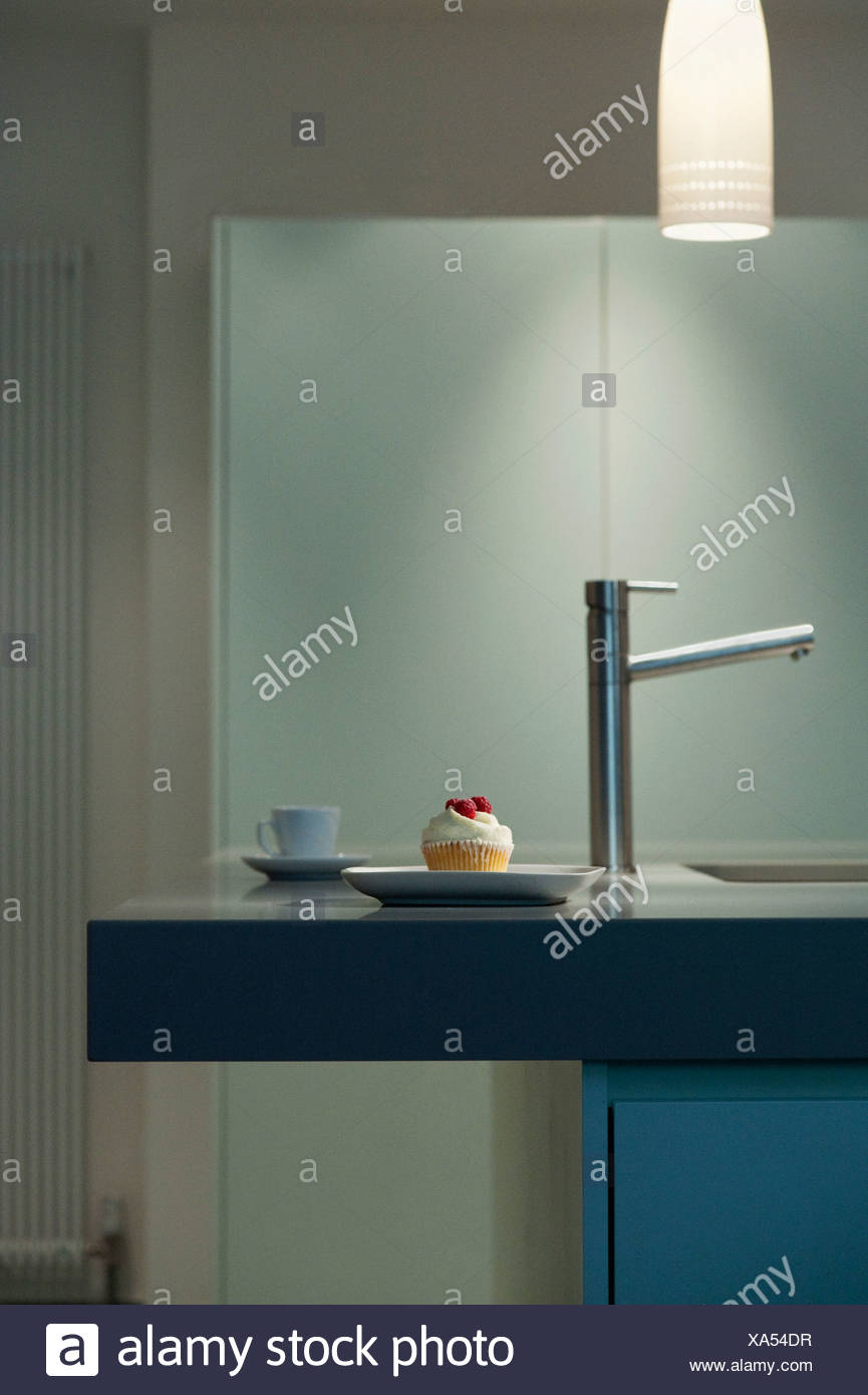 Decorated cupcake on modern counter - Stock Image