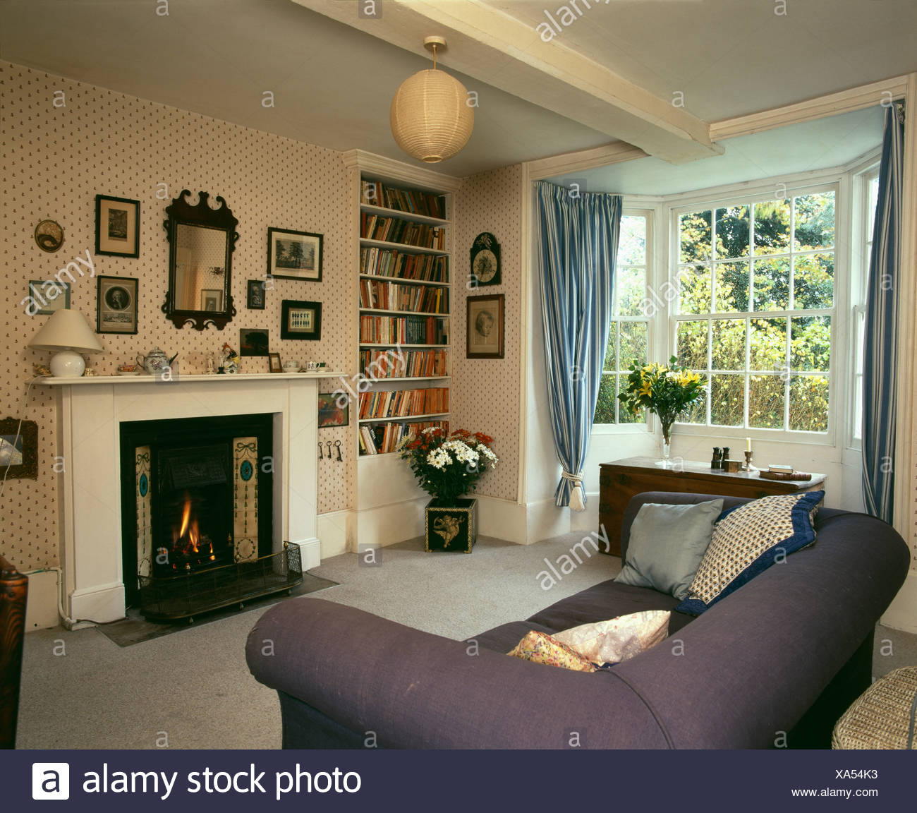 . Country livingroom with fireplace and ornaments suspended from