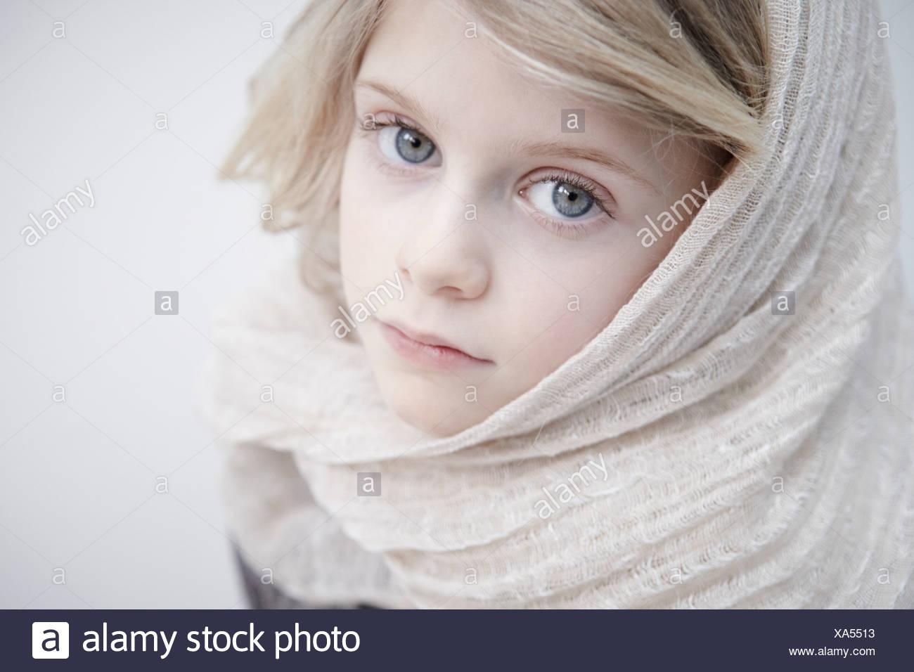Portrait of girl wearing headscarf - Stock Image