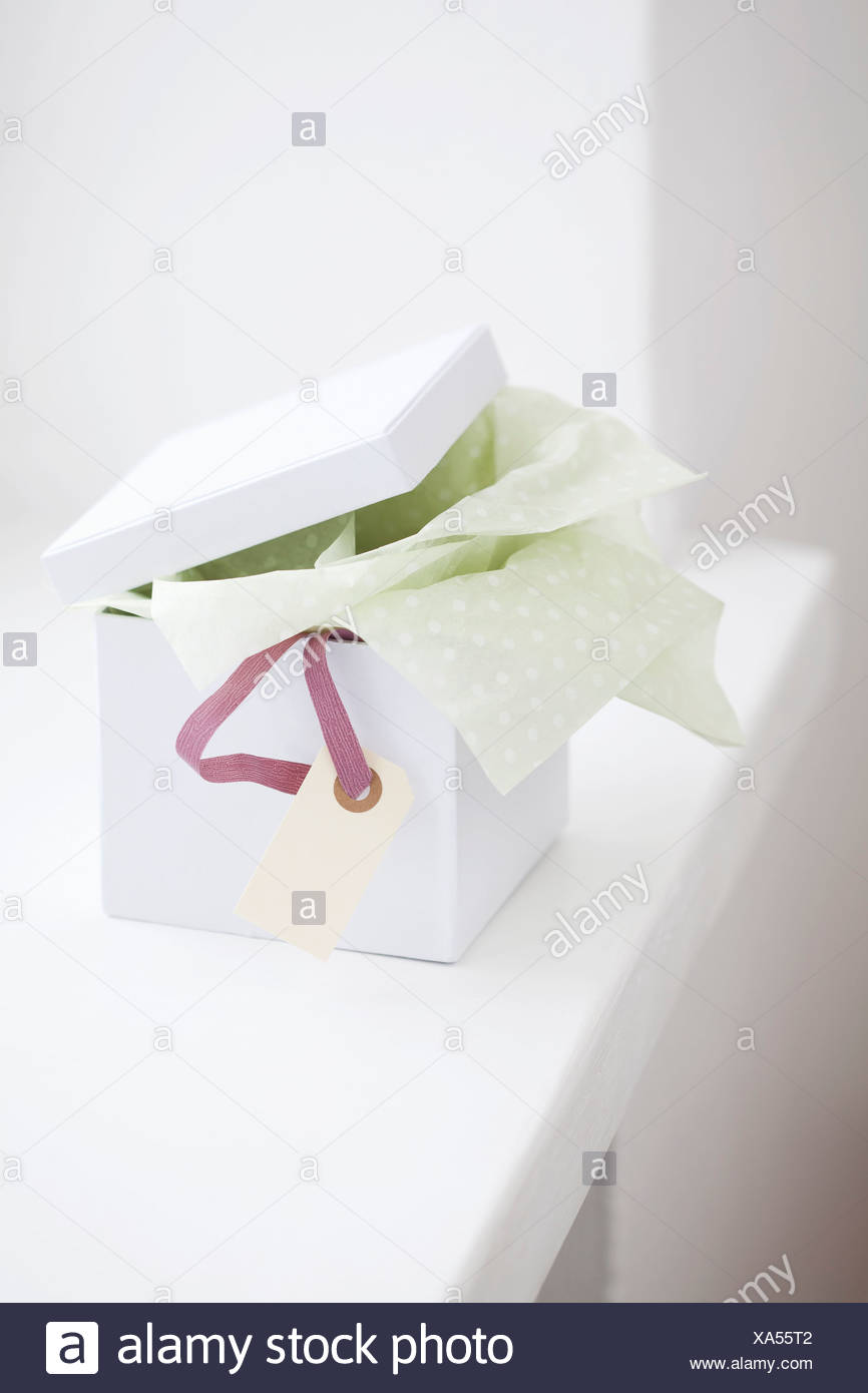 Close up of unwrapped gift box - Stock Image