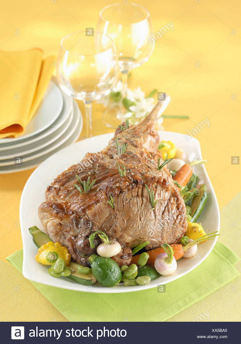 Leg of lamb with spring vegetables - Stock Image