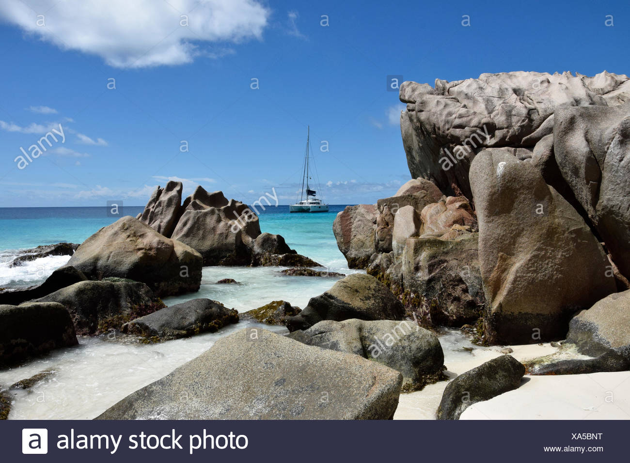 Anse Patatas, boat, granite rock, rock, La Digue, sea, water, Seychelles, Africa, beach, seashore, - Stock Image