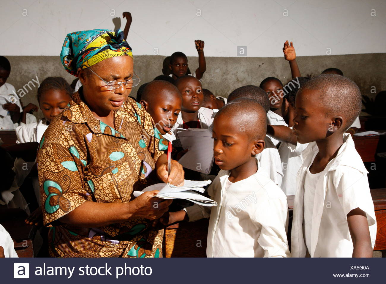 Teacher and school children in school uniform during class, Kinshasa, Congo Stock Photo