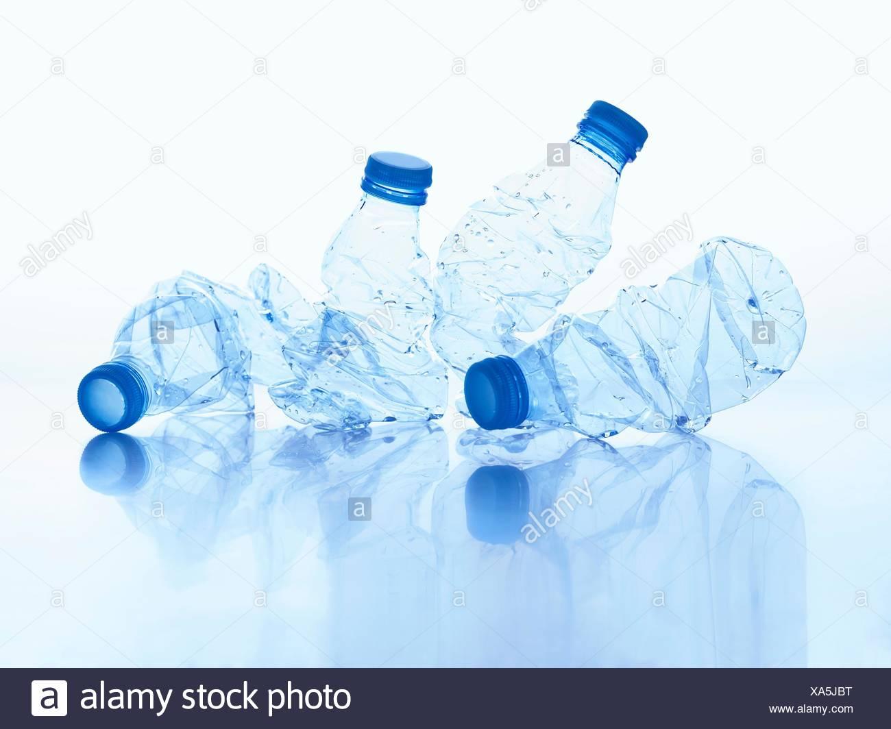 Crushed plastic bottles, studio shot. - Stock Image