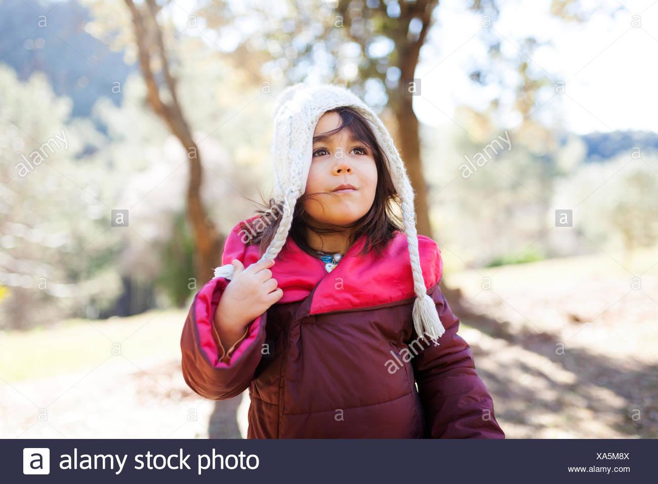 Portrait of little girl wearing a woolly hat - Stock Image