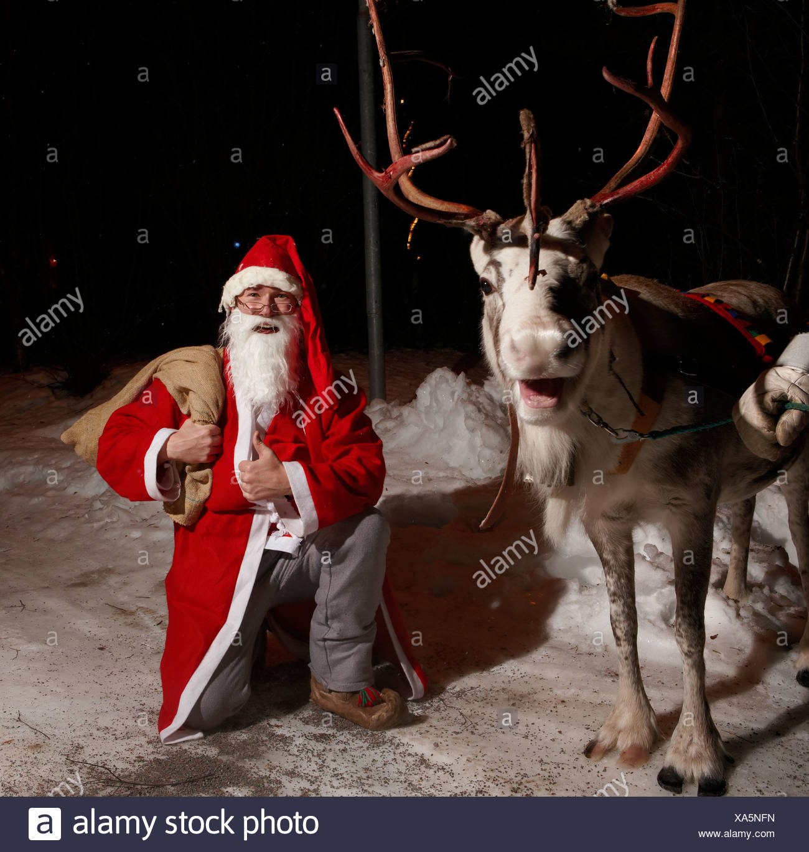 Santa Claus and Reindeer, Jukkasjarvi,  Kiruna, Sweden - Stock Image