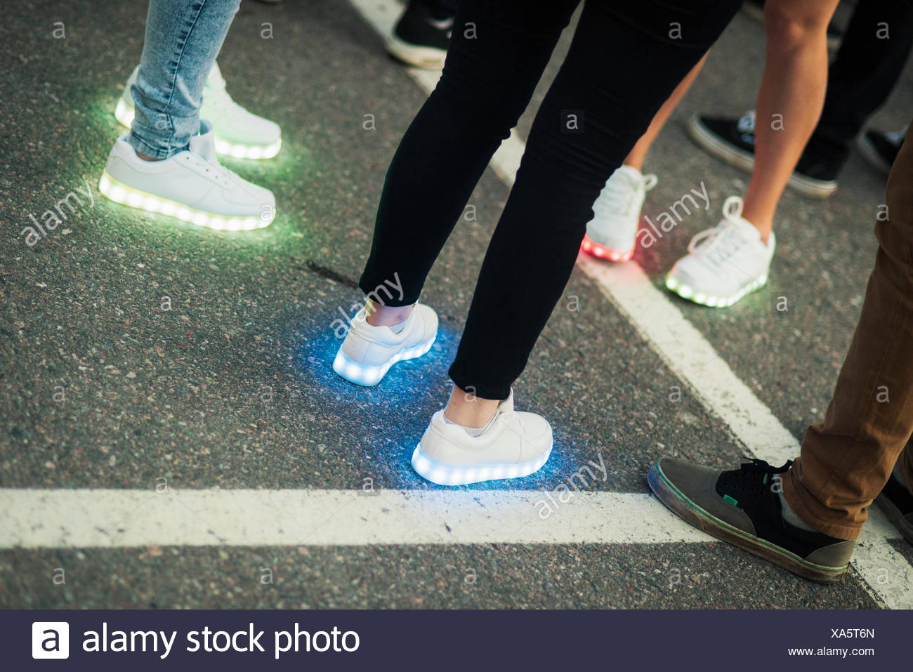 Finland, Varsinais-Suomi, People wearing trainers with glowing sole - Stock Image