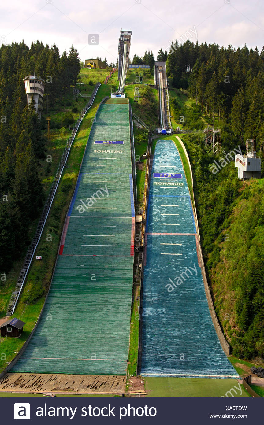 Normal and large ski flying hill, covered with jump mats, Am Kanzlersgrund ski jump complex in summer, near Oberhof, Thuringia - Stock Image