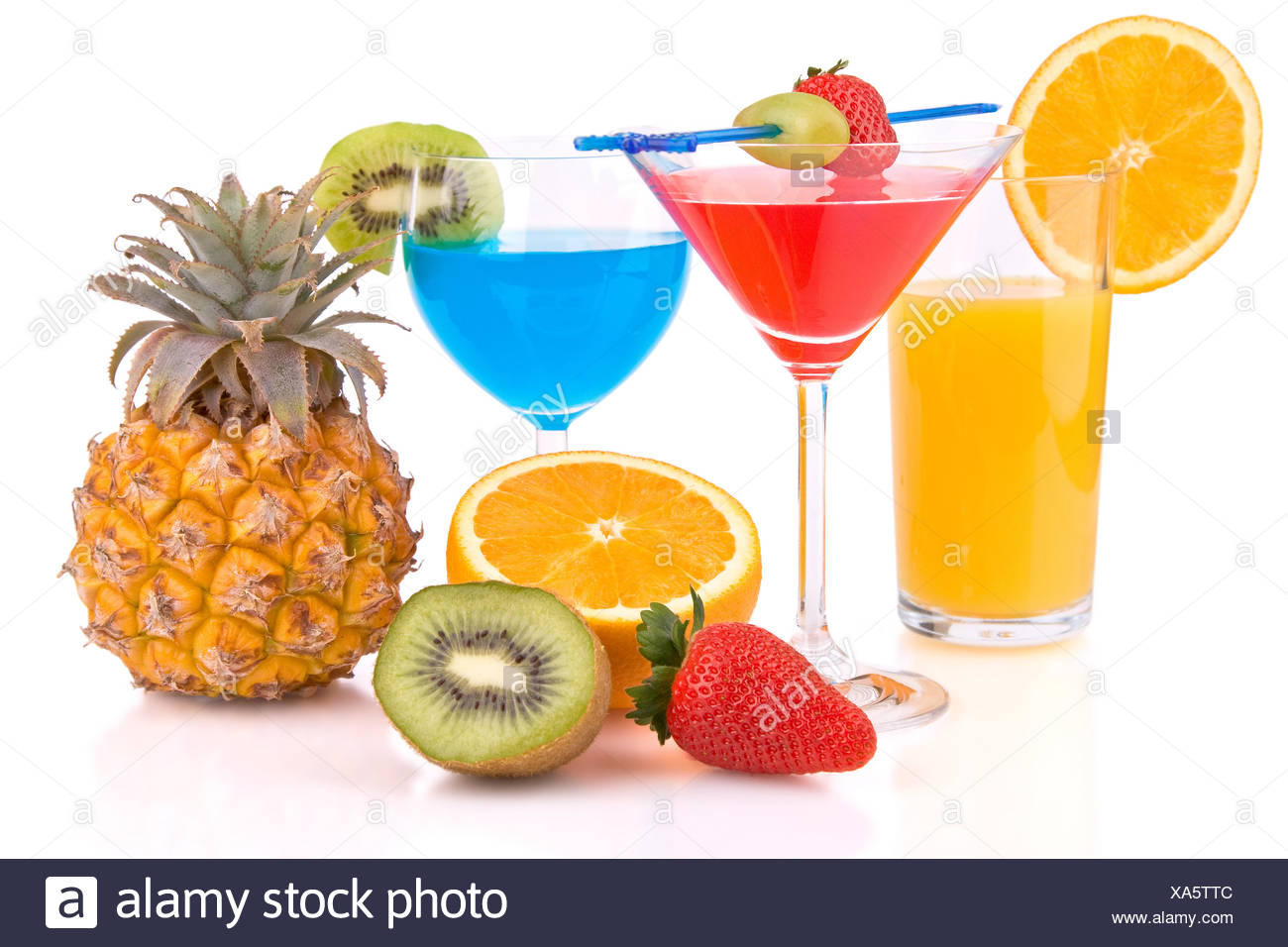 colored cocktails with fruits - Stock Image